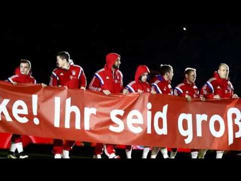 Bayern Munich players hold 'Thank you! You are great!' banner as Allianz Arena blasts out Christmas