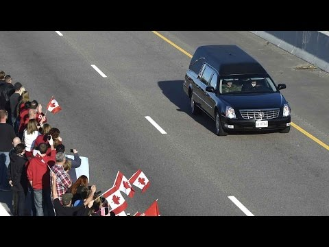 Canadians gathered along overpasses and on highway shoulders to say goodbye to Cpl. Nathan Cirillo, who was killed in front of the National War Memorial on O...