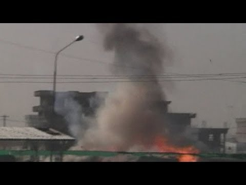 Explosions at Kabul international airport as Taliban launch large attack