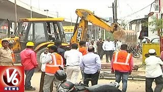 GHMC Officials Hold Footpath Encroachment Demolition Drive In SR Nagar Area