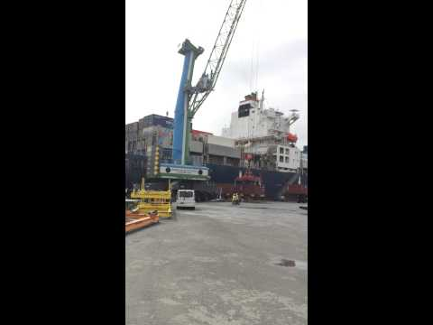 Crane loading container on ship in noumea