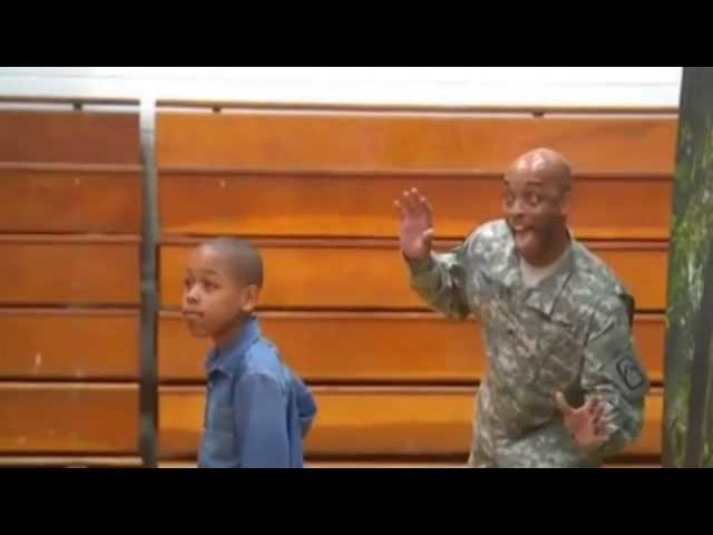 Returning soldier surprises son with adorable school picture photobomb