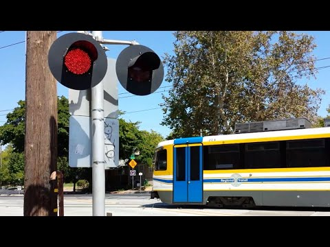 SACRT Light Rail Trains At 21st Street Railroad Crossing. Both Sides