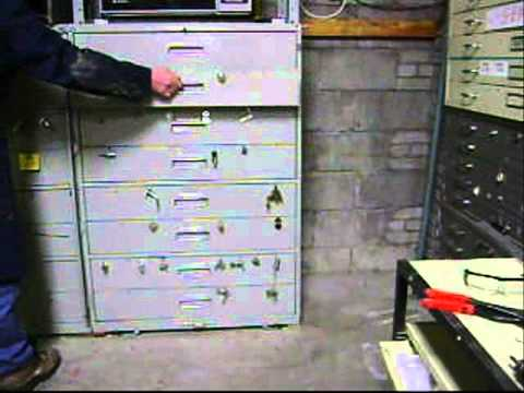 Install file cabinet outside security bar swing a way