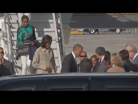 President Obama and family arrive in Cape Town: Obamas to visit Mandela's prison on Robben Island