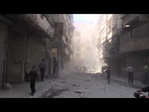the moment of bombing by barrel bomb on citizens - aleppo