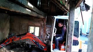 Mini excavator on works