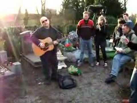 Frank Black plays at the grave of Herman Brood