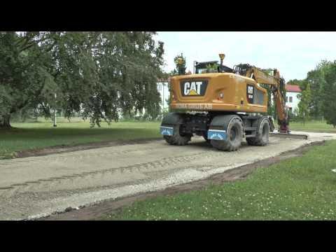 Scania levererar asfalt  2 st Cat grävmaskiner en ny M315F och en M314F och en lastare Volvo L70E vi