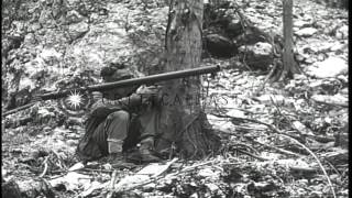 Marine fires flame throwers into entrance of cave at Peleliu Island, Palau. HD Stock Footage
