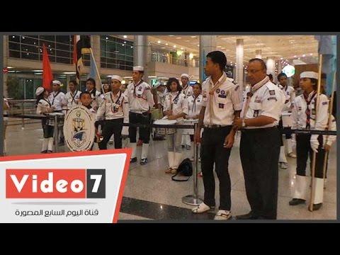 بالفيديو .. عروض الكشافة والورود فى انتظار بعثة مصر لأولمبياد الصين بالمطار