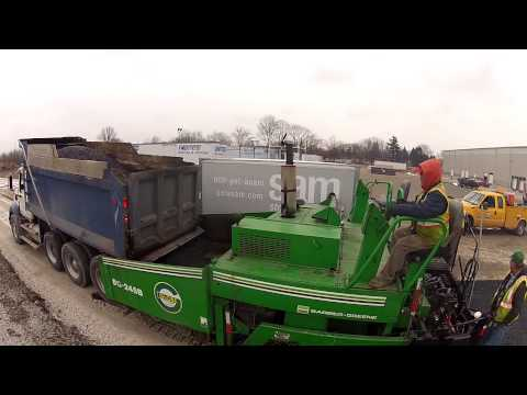Globe Paving lays down the asphalt at Planes Moving & Storage