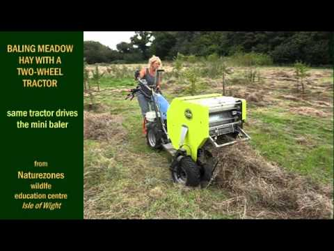 Baling meadow hay with a two-wheel tractor. from Naturezones