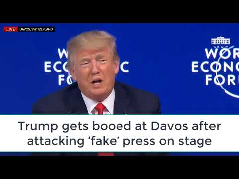 WATCH Trump gets booed at Davos after attacking 'fake' press on stage . FAKE NEWS