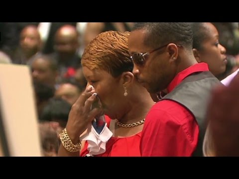 The family of Michael Brown walks into his funeral service