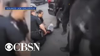 """Video shows police putting """"spit mask"""" on 12-year-old boy"""