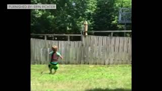Video of 2-year-old playing fetch with dog through fence goes viral