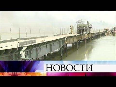 Российские военные вСирии вкратчайшие сроки построили мост через реку Ефрат врайоне Дейр-эз-Зора.