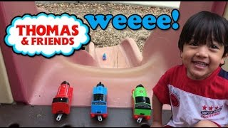 Ryan plays with Thomas and friends toy trains at the Playground