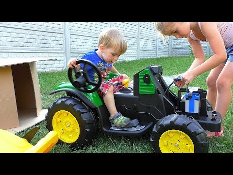 Melissa and Artur unboxing and assembling tractor / The power wheel by MelliArt