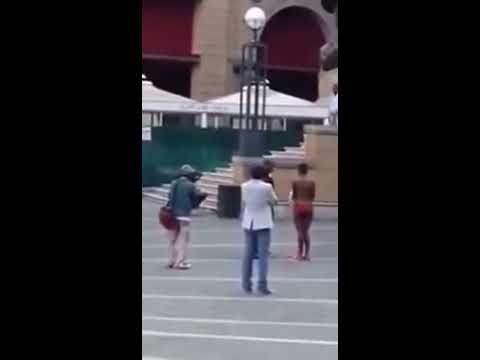 Woman Strips Naked At Nelson Mandela Statue