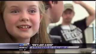 Amazing 8 year old girl starts lemonade stand to help Army vet and assistance dog