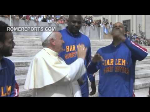 The Harlem Globetrotters teach Pope Francis how to spin a basketball on his fingers