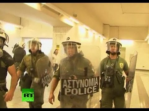 Video: Riot police storm Athens metro during strike demo