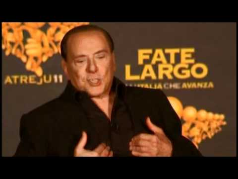 Scandal-hit Berlusconi resigns as PM