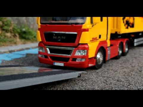 Realistic RC experience - tractor trailer self-loader DHL sangcha video....avi