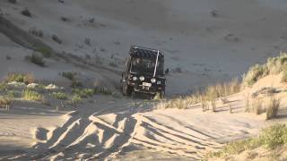 Land Rover Defender 4x4 in sand dunes