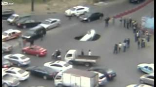 video Just yesterday (30 November 2014), A driver in China managed to jump out of his car just moments before it was swallowed by a sinkhole. The 13ft (4m) wide ch...