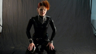 Heels,spikes & one black latex catsuit