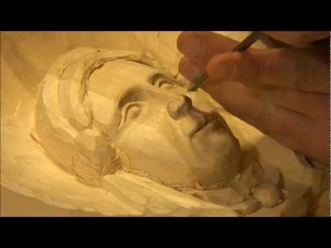 Carving a female face in wood