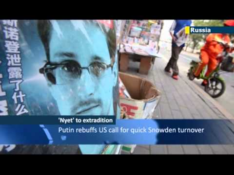 Putin says Kremlin has warned Edward Snowden not to continue damaging Russia's ties with the US