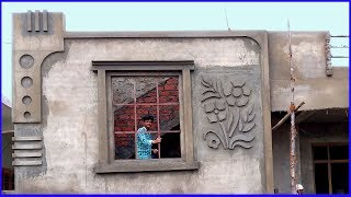 Beautiful Design on Wall-Sand and Cement construction work-Front elevation-2 bedroom house