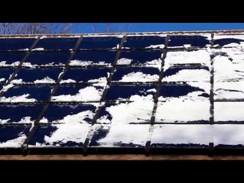 Snow Melting off Silicon Energy Modules on Cherokee Park United Church in St. Paul, Minnesota