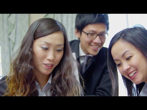 Young Asian business partners in a meeting, discuss their business strategy. Stock Footage