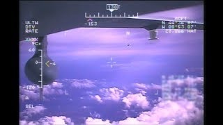 Surveillance Video of UAV Drone in Air to Air Tracking and Reconnaissance of  Executive Jet Aircraft
