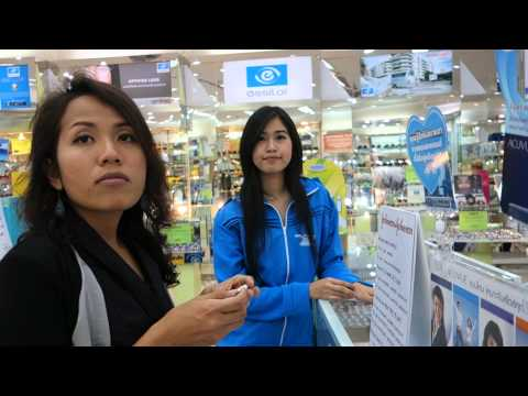 Discussing contact lenses in a shop in Bangkok