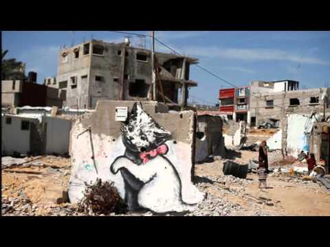 "Street art of Banksy in Palestine with David Rovics singing ""Occupation"" Video by Eitan Altman"