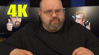Large Man With Beard Livestreams While Wearing Black Shirt (4K)