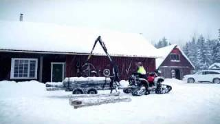Vahva Jussi 320 Honda ATV with tracks in snow