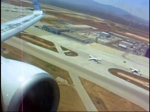 A very long take off of a KLM Boeing 737-800 plane from Athens, Greece on a scorching hot day in August. Presumably the length of the takeoff roll was due to...