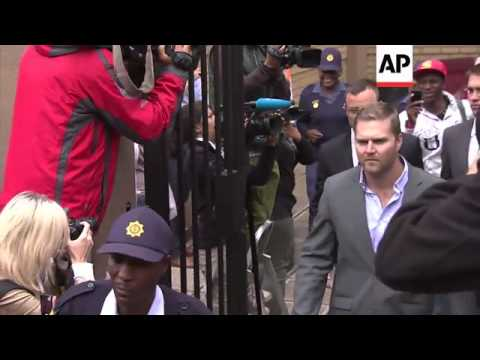 Oscar Pistorius departs court following day when prosecution questioned forensic evidence