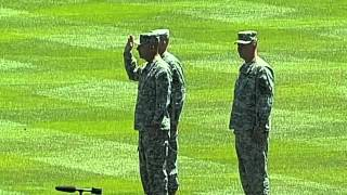 Soliders re-enlist into the US Army at Coors Field
