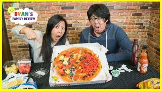Pizza Challenge Mommy vs Daddy with Spicy Hot Cheetos and Extreme Sour Candy