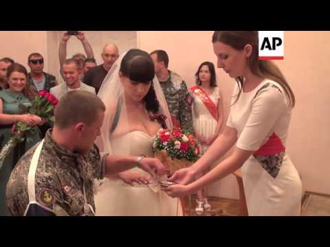 Fighters bearing flowers as rebel commander weds sweetheart in Donetsk