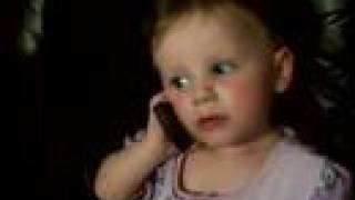 baby talking to dad on phone funny girl