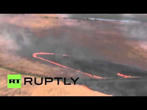Russia: EMERCOM helicopters battle wildfire at Astrakhan Nature Reserve